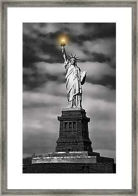 Statue Of Liberty At Dusk Framed Print by Daniel Hagerman