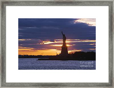 Statue Of Liberty At Sunset Framed Print by Jeremy Woodhouse