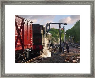 Steam Train Taking On Water Framed Print by Gill Billington