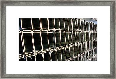 Steel Studs Framed Print by Ron Bissett