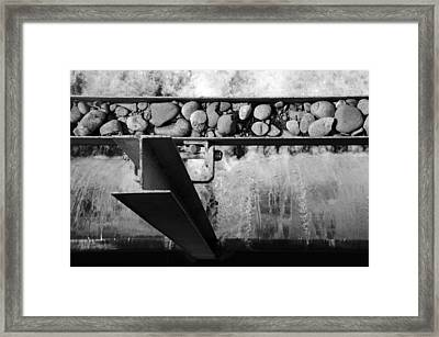 Steel Water Rocks Framed Print by Alasdair Turner
