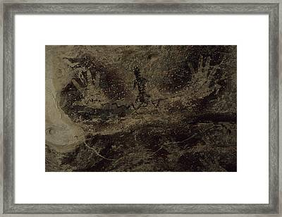 Stenciled Hands Over 10,000 Years-old Framed Print by Carsten Peter
