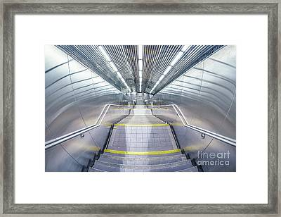 Stepping Down To The Underground Framed Print by Evelina Kremsdorf