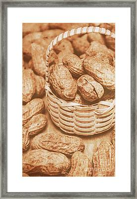 Still Life Peanuts In Small Wicker Basket On Table Framed Print by Jorgo Photography - Wall Art Gallery