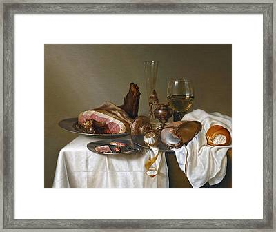 Still Life With A Ham A Glass And A Nautilus Cup On A Table Draped With A White Cloth Framed Print by Maerten Boelema de Stomme