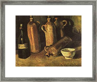 Still Life With Four Stone Bottles, Flask And White Cup, 1884 Framed Print by Vincent Van Gogh