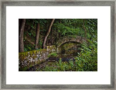 Stone Arch Bridge Path And Flowing Creek Stream In Lush Forest Countryside Landscape Framed Print