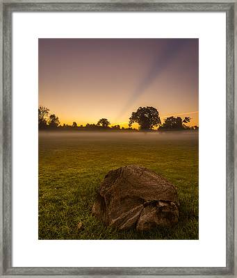 Stone Before A Misty Meadow Framed Print