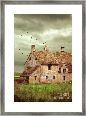 Stone Cottage And Stormy Sky Framed Print by Jill Battaglia