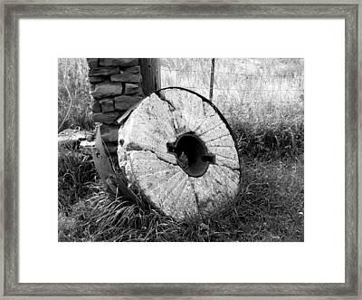 The Old Stone Grinding Wheel Framed Print