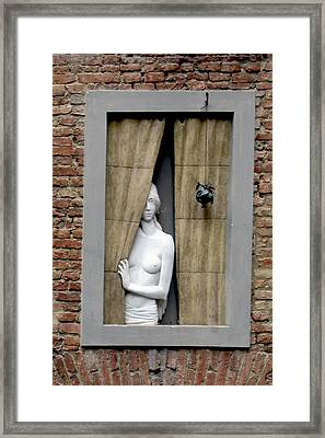 Stone Hearted Woman Peaking Out Of Window Framed Print by Michael Riley