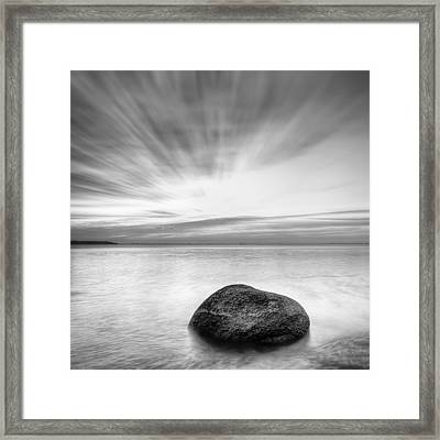 Stone In The Sea Framed Print