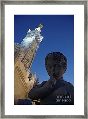 Stone Statue Of A Cherub With View Of The Bell Tower Of Notre Dame De La Garde In Marseille Framed Print
