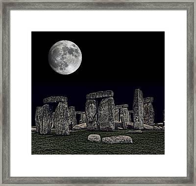 Stonehenge Moon Framed Print by Daniel Hagerman