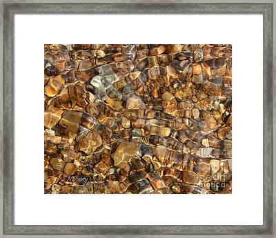 Stones Through Ripples Framed Print
