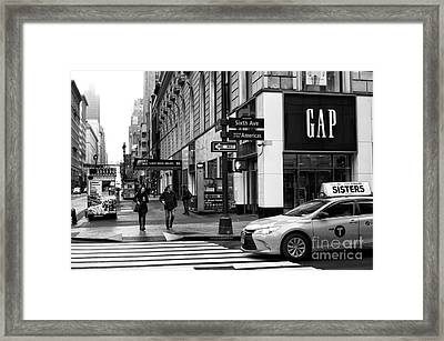 Stopping On 6th Avenue Framed Print by John Rizzuto