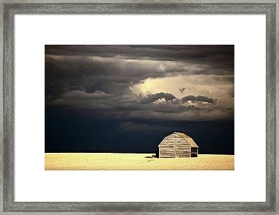 Storm Clouds Behind Abandoned Saskatchewan Barn Framed Print