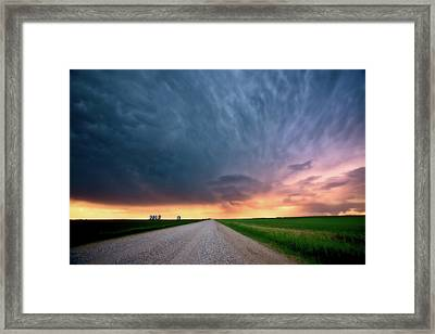 Storm Clouds Over Saskatchewan Country Road Framed Print by Mark Duffy