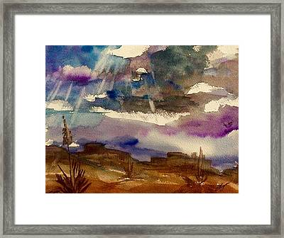 Storm Clouds Over The Desert Framed Print by Ellen Levinson