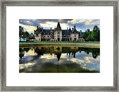 Storm Clouds Roll Over Biltmore As Sun  Sets Framed Print by Carol R Montoya