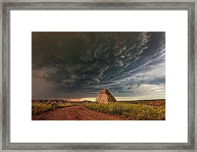 Storm Over Dinosaur Framed Print