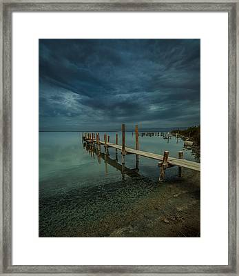 Storm Over The Dock Framed Print