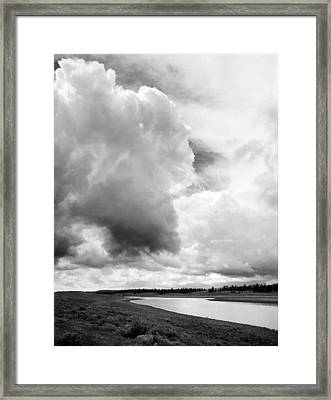 Storm Over The River Framed Print