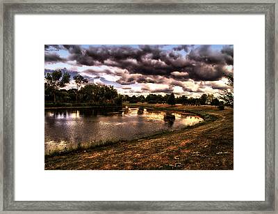 Storm Passing The Fishing Hole Framed Print by Thomas Woolworth