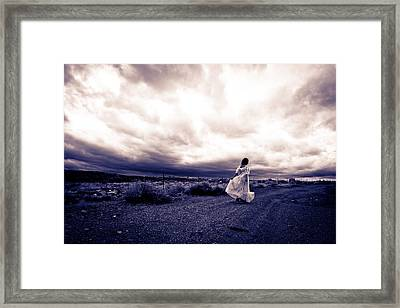 Storm Walk Framed Print
