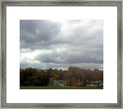 Storms A Brewin' Framed Print by Emily Kelley