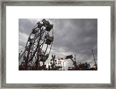 Stormy Ferris Wheel Framed Print by Daniel Ness