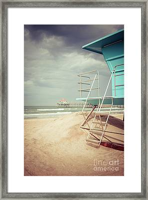 Stormy Huntington Beach Pier And Lifeguard Stand Framed Print by Paul Velgos