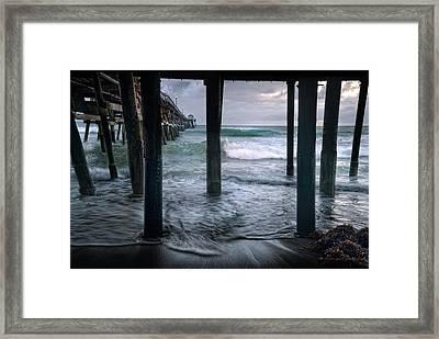 Stormy Pier Framed Print by Gary Zuercher