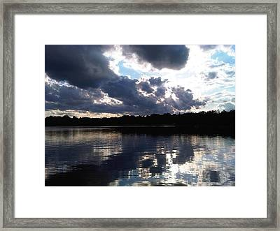 Stormy Reflections Framed Print by Jessica Yudis