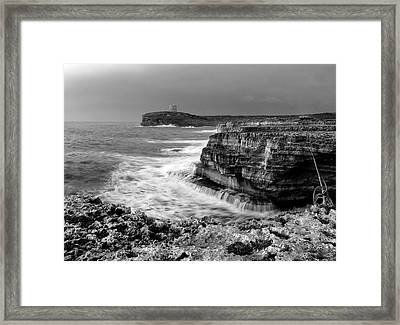 Framed Print featuring the photograph stormy sea - Slow waves in a rocky coast black and white photo by pedro cardona by Pedro Cardona