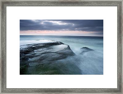 Stormy Shore Framed Print by Eric Foltz