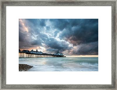 Stormy Sunrise Over Eastbourne Pier Framed Print