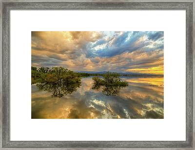 Stormy Sunset Reflections Framed Print