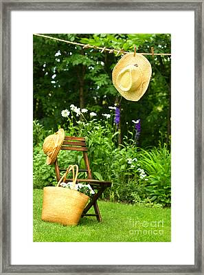 Straw Hat Hanging On Clothesline Framed Print by Sandra Cunningham