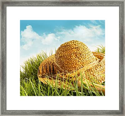 Straw Hat On Grass With Blue Sky  Framed Print by Sandra Cunningham