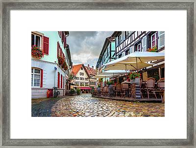 Street Cafe After The Rain Framed Print by Dmytro Korol