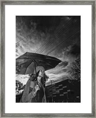 Walking Into The Dark Rain Framed Print