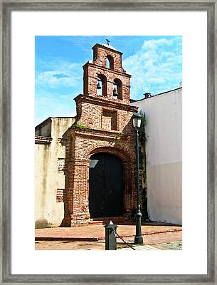 Streetlight Bells And Cross Framed Print by Douglas Barnett