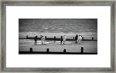 Striding Into The Sea Framed Print by Martin Newman