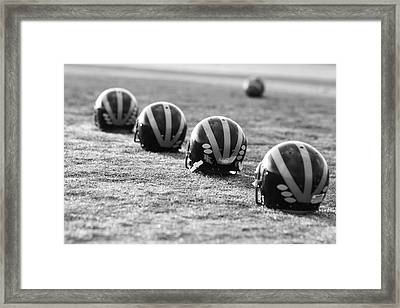 Striped Helmets On The Field Framed Print