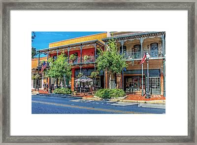 Strolling Down Palafox Street Framed Print by Lynn Jordan