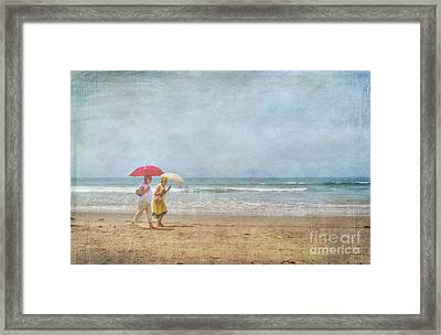 Framed Print featuring the photograph Strolling On The Beach by David Zanzinger