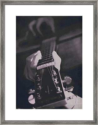 Strum Framed Print