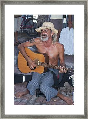 Strumming A Tune In Key West Framed Print by Carl Purcell