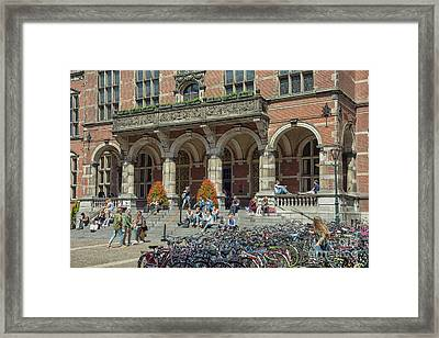 Students In The Sun In Front Of University Framed Print by Patricia Hofmeester